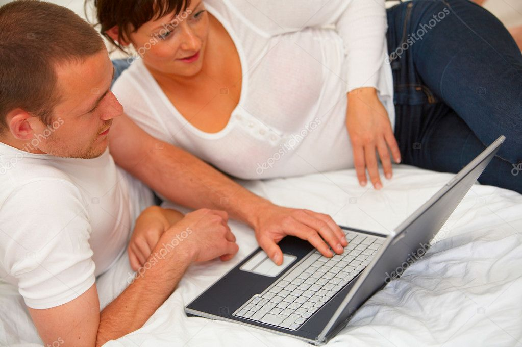 Young couple browsing the internet. Working at home  Stock Photo #3199377