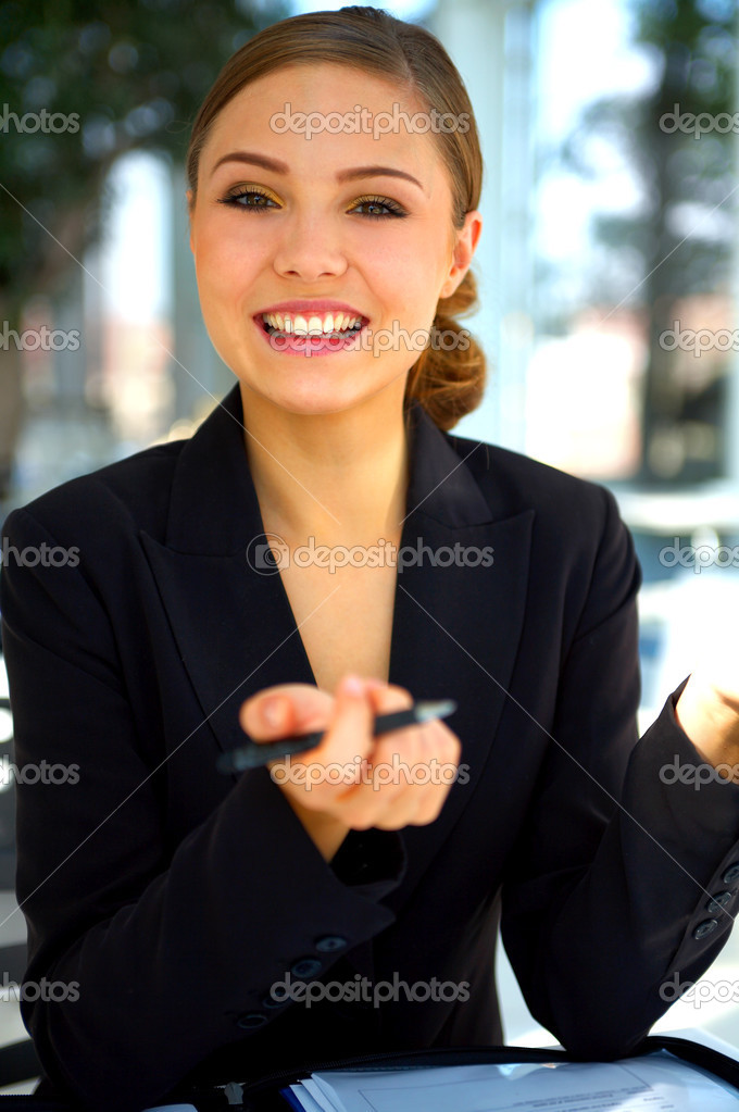 Young businesswoman explaining things. This model was very expensive so please download her. :) — Stock Photo #3199752