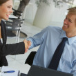 Royalty-Free Stock Photo: Two businesspeople shaking hands.