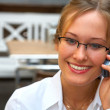 Royalty-Free Stock Photo: Female businesswoman making a phone call.