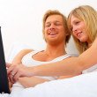 Young couple browsing the internet - Stock Photo