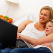 Royalty-Free Stock Photo: Young couple browsing the internet