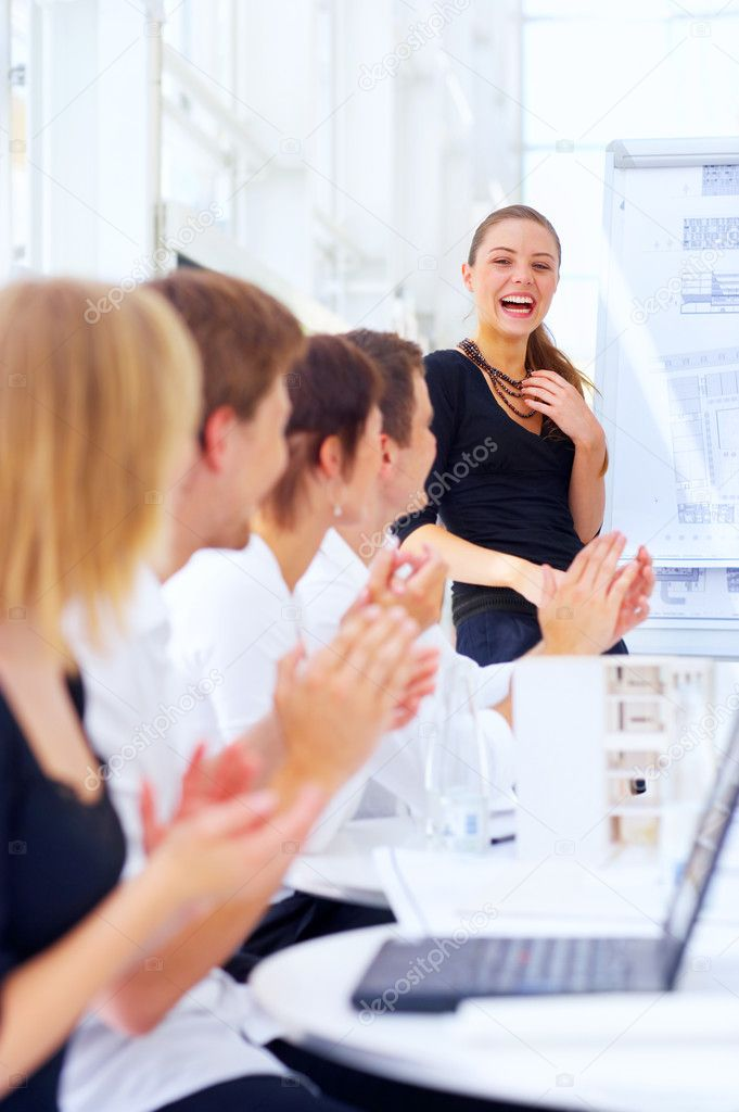 A young attractive female architect being applauded for her presentation.  — Stock Photo #3214797