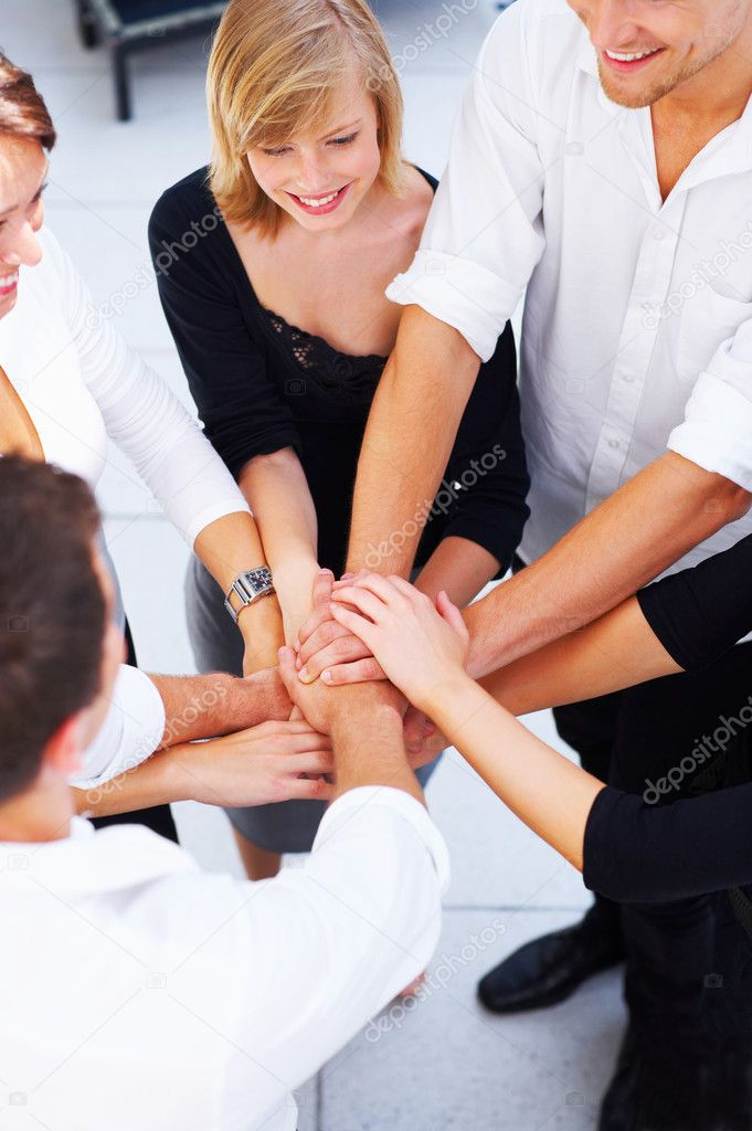 Hands on top of each other. Symbolic picture.   Stock Photo #3214882