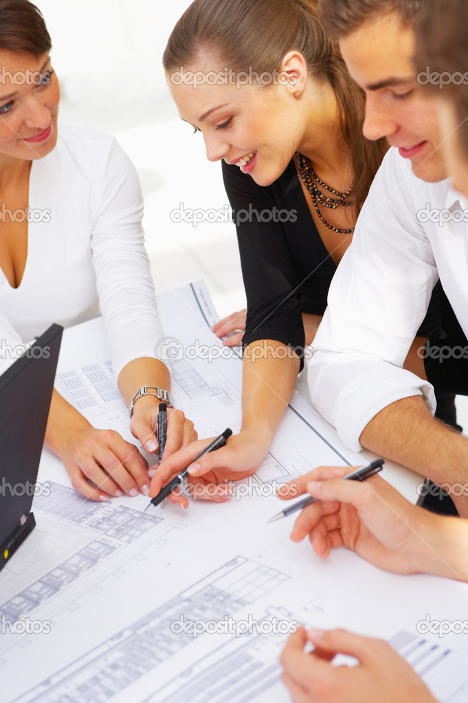 A group of architects discussing the plans for a new building — Foto de Stock   #3214897