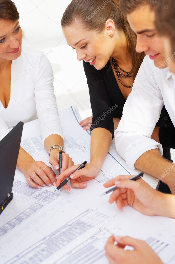 A group of architects discussing the plans for a new building — Stockfoto #3214897