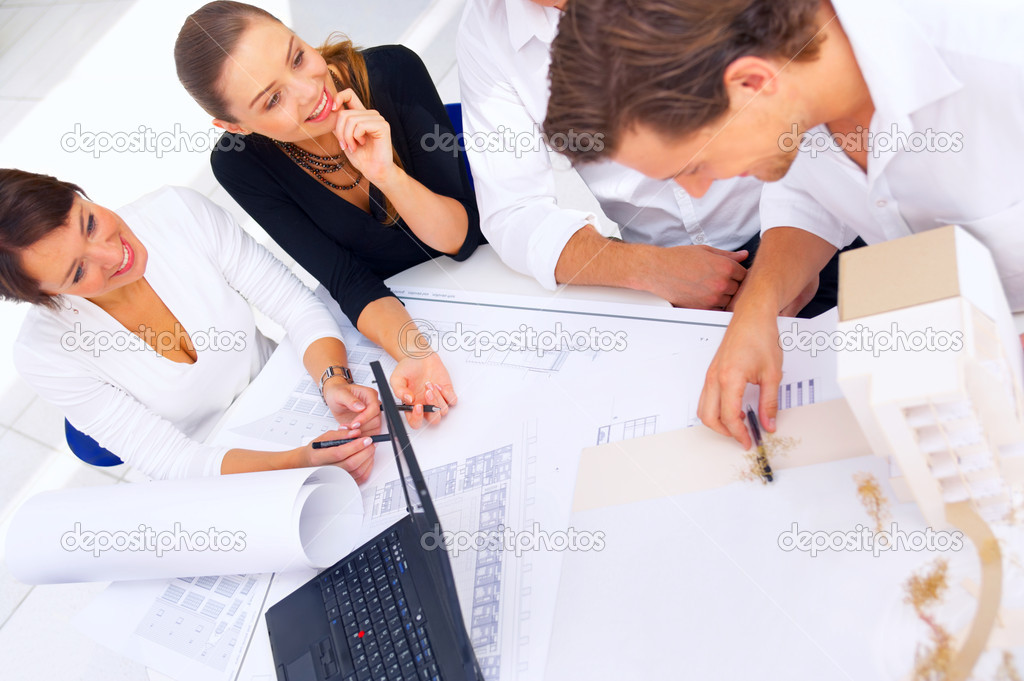 A group of architects discussing the plans for a new building  Stock Photo #3214916