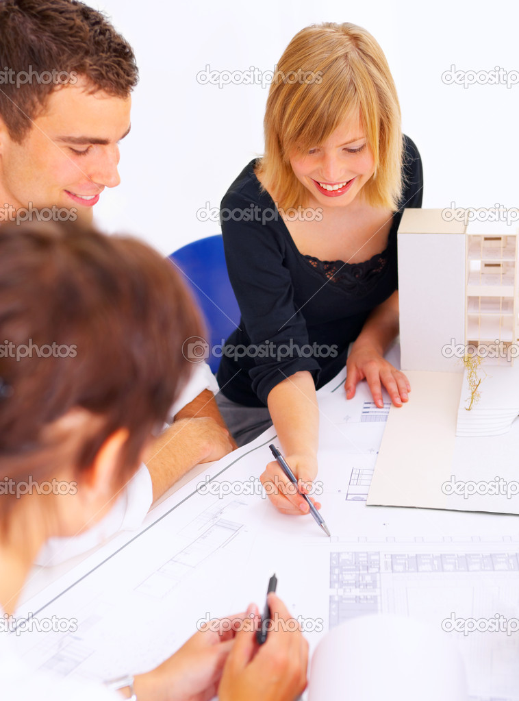 A group of architects discussing the plans for a new building — Stock Photo #3214938