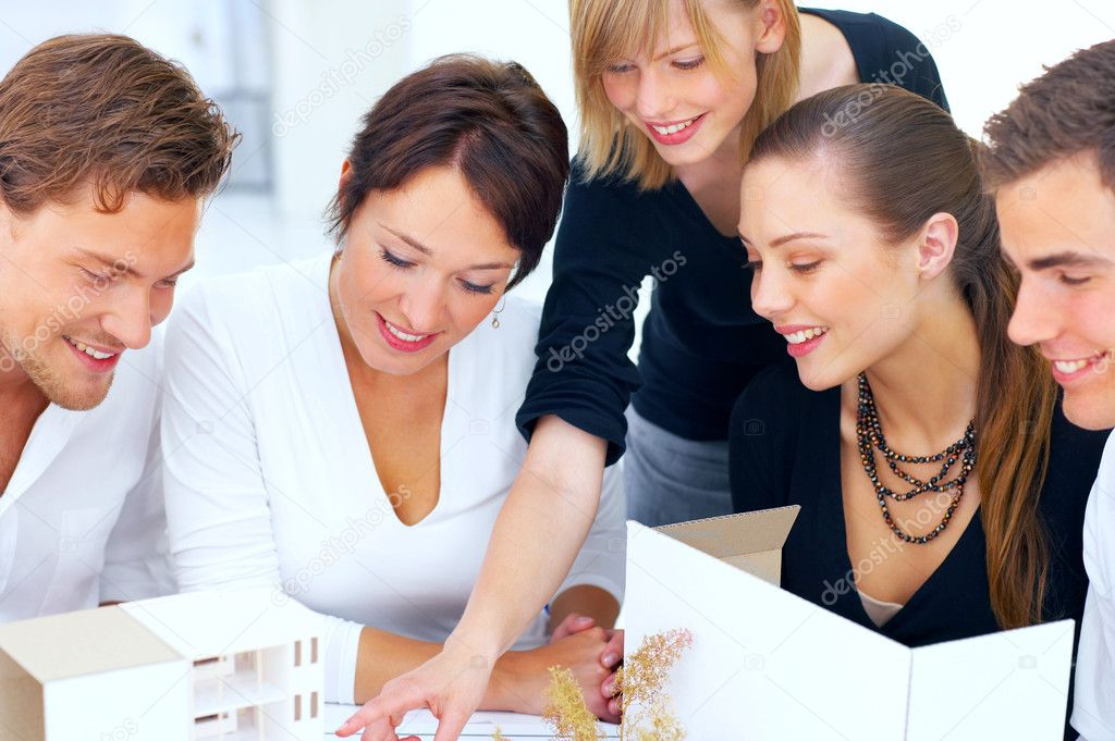 A group of architects discussing the plans for a new building — Stock Photo #3215501