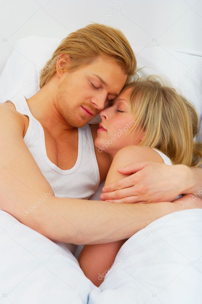 Young couple embracing in bed. A sensual and cute couple.  — Stock Photo #3216654