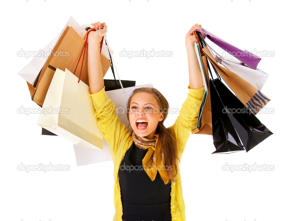 Portrait of an attractive young woman holding several shoppingbags. — Stock Photo #3219924