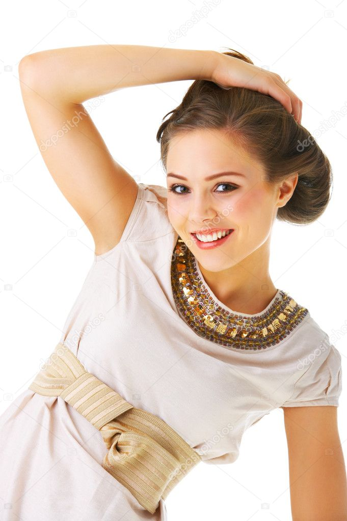 An isolated fashion portrait of a beautiful young girl in fashionable clothes.  Stock Photo #3219976
