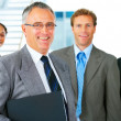 Business team and a leader - Stock Photo
