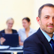 Handsome business leader - Stock Photo