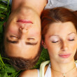 Royalty-Free Stock Photo: Sleeping couple lying in the grass