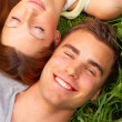 Royalty-Free Stock Photo: Young couple lying in the grass