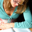 Young Woman Reading and Studying. - Stock Photo