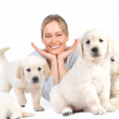 Cute puppies and young hot female model - Stock Photo