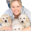 Royalty-Free Stock Photo: Cute puppies and young cute female model