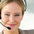 Young business woman using head phone - Stockfoto