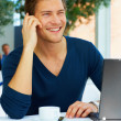 Casual Young Man on the Phone - Stockfoto