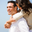 Royalty-Free Stock Photo: Smiling young couple piggybacking