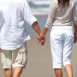 Royalty-Free Stock Photo: Young couple in love walking on beach