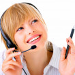 Hotline operator with headset - Stock Photo