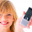 Royalty-Free Stock Photo: Young girl holding out phone