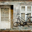 Old House and old bike vintage style - Stock Photo