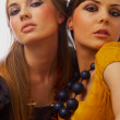 Fashion shot of 2 beautiful models - Stock Photo