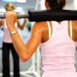Women weight training in a fitness center - Stock Photo