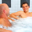 Two men in jacuzzi - Stock Photo
