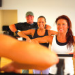 Weight training in a fitness center - Stok fotoğraf
