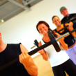 Weight training in a fitness center - Stock Photo