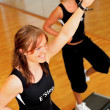 Women stepping in a fitness center - Stockfoto