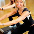 Royalty-Free Stock Photo: Women stepping in a fitness center