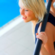 Weight trainer besides a pool - Stock Photo