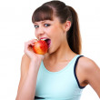 Young girl holding a green apple - Stock Photo