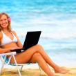 Royalty-Free Stock Photo: Beautiful Young Woman on the Beach with Laptop