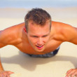 Fitness Shot of a Young Man on the Beach - Stock Photo