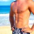Fashion Shot of a Young Man on the Beach - Stock Photo