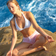 Meditating by the Sea - Stock Photo