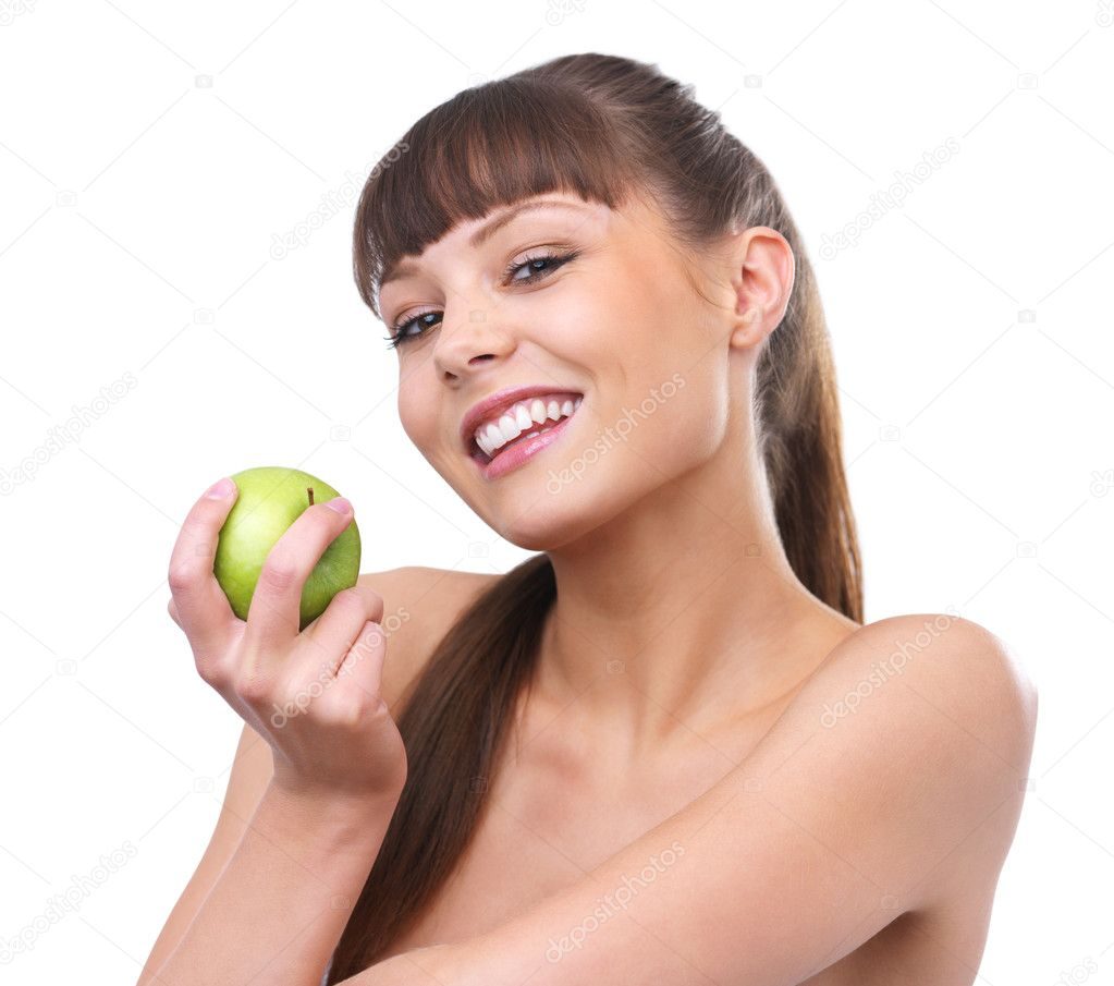 Got your attention? Beautiful naked young girl holding a green apple reminding you to keep a healthy diet.  — Stock Photo #3220257