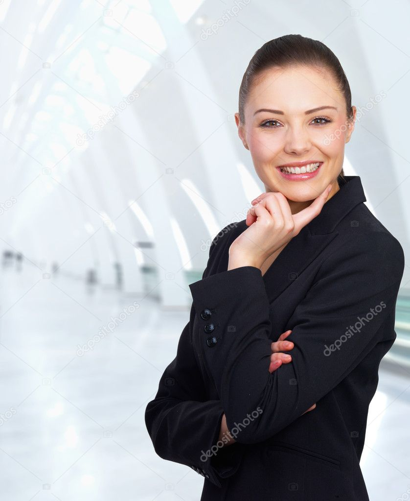 Closeup of a young smiling business woman standing in a light and mordern office business building.  — Stock Photo #3220264