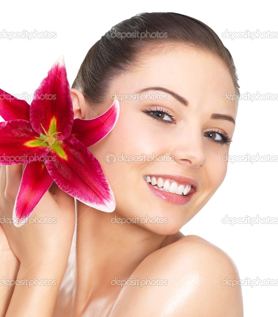 Beautiful portrait of a young sexy woman with a bright red flower. — Stock Photo #3220281