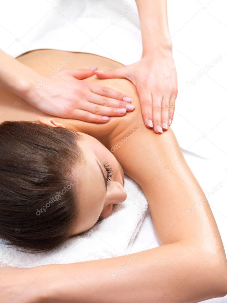 Massage therapy and hands massaging - Portrait of a pretty young girl getting a massage at the day spa — Stock Photo #3220338