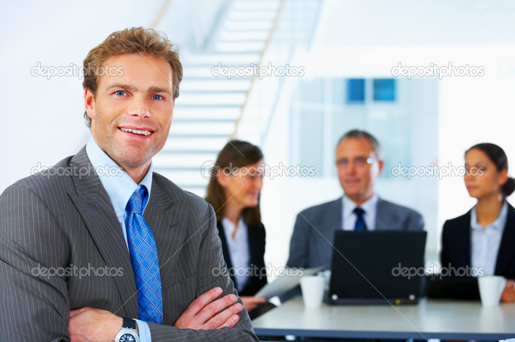 Business team and a leader - Mature business man with his colleagues in the background — Foto Stock #3220388