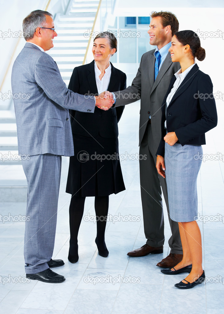 Handshake and teamwork. Two businessmen shaking hands in a light and modern office environment. — Stock Photo #3220394