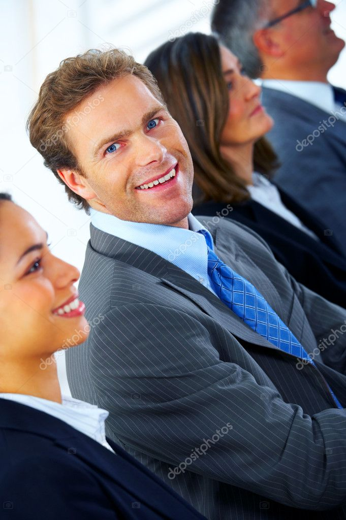 Business team and a leader - Mature business man with his colleagues in the background — Stock Photo #3220497